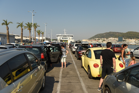 Split, Croatia - August 19, 2017: Cars waiting for ferry boarding in port of Split, Croatia.