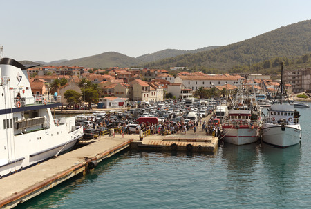 Vela Luka, Croatia - August 19, 2017: Cars and people waiting for ferry boarding in port of  Vela Luka on island Korcula, Croatia.