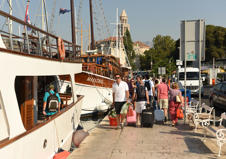 Split, Croatia - August 19, 2017: People in port of Split, Croatia.
