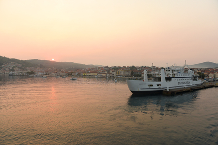 Vela Luka, Croatia - August 19, 2017: Sunrise in port of Vela Luka on island Korcula, Croatia.