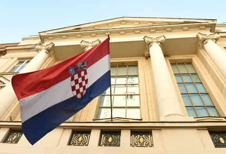 Zagreb, Croatia - August 18, 2017: Croatian flag at the Croatian Parliament building (Hrvatski sabor) in Zagreb.