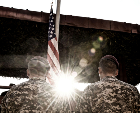 American Soldiers and US Flag with sunlight