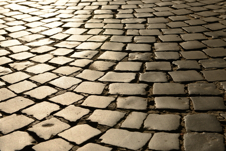 Old pavement road, texture. Texture of stone pavement tiles cobblestones, background, pavement stone.