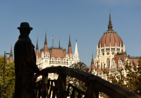 Statue of Imre Nagy and Parliament Building in Budapest, Hungari Stock Photo