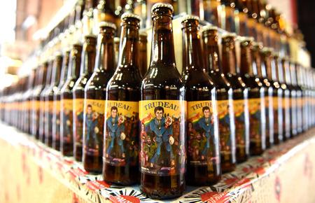 Lviv, Ukraine - NOV 16, 2017: A bottles of beer featuring Canadian Prime Minister Justin Trudeau brewed in Pravda beer restaurant in western Ukrainian city of Lviv.