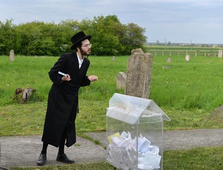 Belz, Ukraine - May 11, 2015: Ultra-orthodox Jews prayed on tombs of Tazdikim in Belz town, Lviv region.