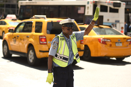NEW YORK, USA - May 30, 2018: NYPD police officer performing his duties on the streets of Manhattan. Editorial