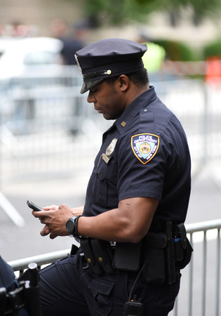 NEW YORK, USA - June 10, 2018: Police officer performing his duties on the streets of Manhattan. New York City Police Department (NYPD).