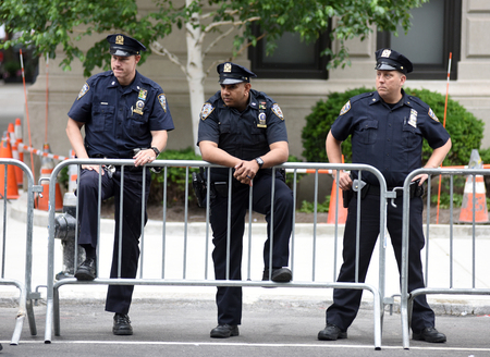 NEW YORK, USA - June 10, 2018: The New York City Police Department (NYPD) police officers providing security on the streets of Manhattan.