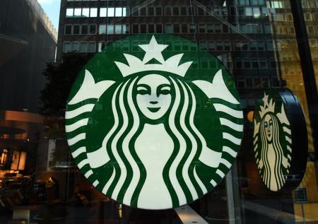 New York, USA - May 26, 2018: Starbucks Coffee logo at Starbucks cafe in Midtown of Manhattan. Editorial
