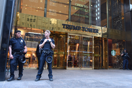 New York, USA - May 25, 2018: NYPD officers providing security at Trump Tower on Fifth Avenue in New York. Editorial