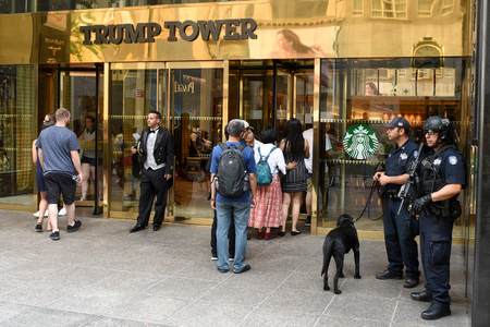 New York, USA - May 25, 2018: NYPD officers providing security at Trump Tower on Fifth Avenue in New York. Redakční