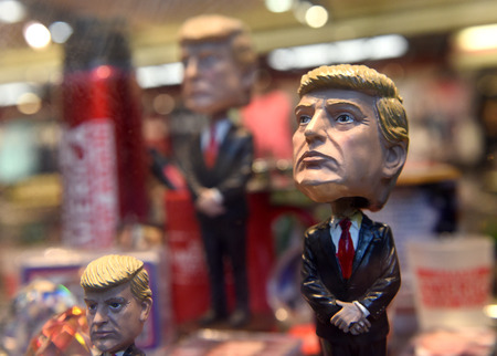 New York, USA - May 31, 2018: Donald Trump bobble head other souvenirs in the gift shop in New York. Editorial