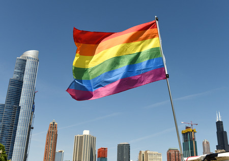 A rainbow flag with Chicago cityscape, USA