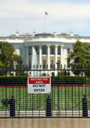 Washington, DC - June 01, 2018: Sign with the inscription 'RESTRICTED AREA, DO NOT ENTER' on the fence around The White House, Washington DC. Editorial