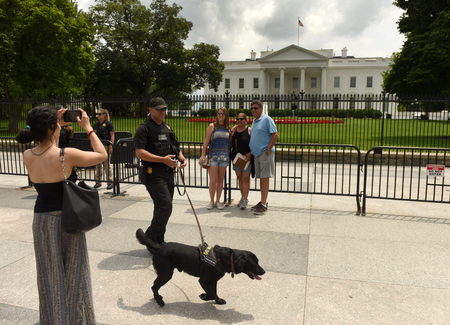 Washington, DC - June 02, 2018: Tourists and Secret Service guard near The White House, Washington DC. Editorial
