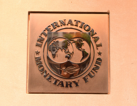 Washington, DC - June 04, 2018: Emblem of International Monetary Fund on the Headquarters 2 Building (HQ2) in DC. 報道画像