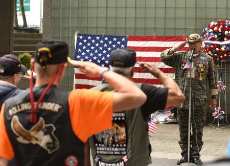 New York, USA - May 28, 2018: Vietnam Veterans  salutes during meeting on Memory Day on New York Vietnam Veterans Memorial.