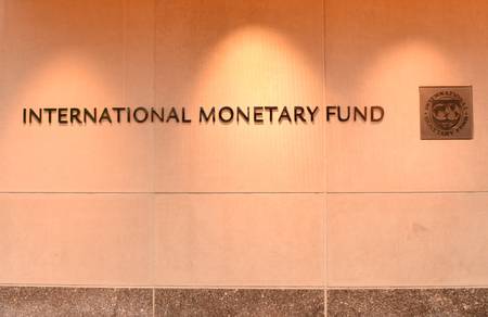 Washington, DC - June 04, 2018: Emblem of International Monetary Fund on the Headquarters 2 Building (HQ2) in DC. Editöryel