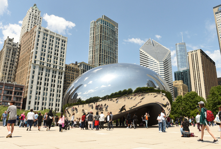 Chicago, USA - June 05, 2018: People near the Cloud Gate, a public sculpture by Anish Kapoor at Millennium Park. Cloud Gate, also known as the Bean one of Chicago's most famous attractions. Editorial