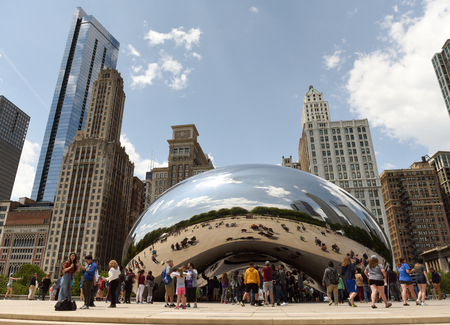 Chicago, USA - June 05, 2018: People near the Cloud Gate, a public sculpture by Anish Kapoor at Millennium Park. Cloud Gate, also known as the Bean one of Chicagos most famous attractions.