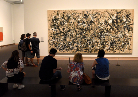 New York, USA - May 26, 2018: A visitors looks at the Jackson Pollock paintingin the Metropolitan Museum of Art in New York City.