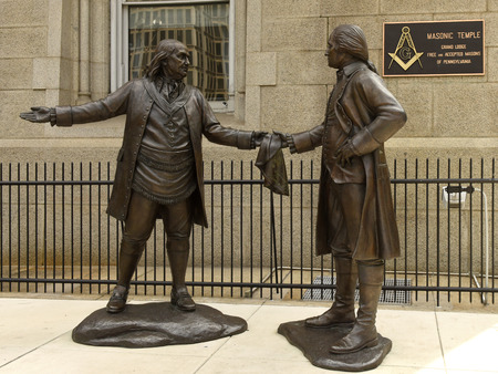 Philadelphia, PA, USA - May 29, 2018: Statue of Benjamin Franklin handing a Masonic apron to George Washington in front of Masonic Temple in Philadelphia.