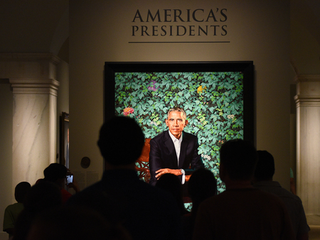 Washington, DC - June 01, 2018: People near the portrait of the 44th president of the United States Barack Obama by Kehinde Wiley in National Portrait Gallery in DC. Editorial
