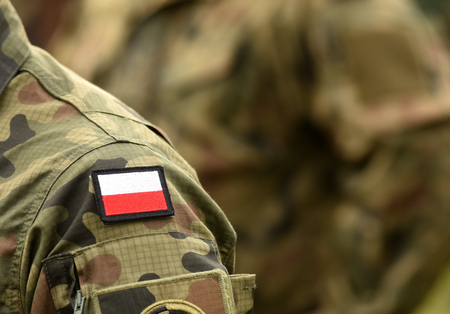 Polish patch flag on soldiers arm. Poland military uniform. Poland troops
