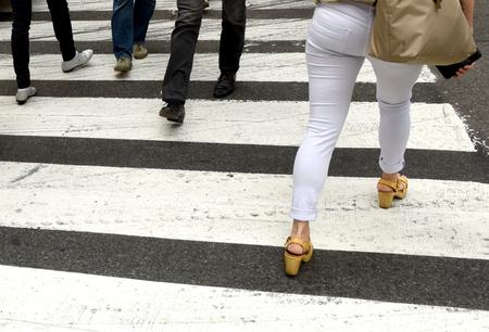 people on zebra crossing. feet of pedestrians walking on zebra crossing Stock Photo - 109880781
