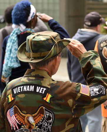 New York, USA - May 28, 2018: Vietnam Veterans salutes during meeting on Memory Day on New York Vietnam Veterans Memorial. Editorial