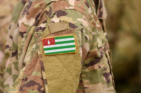 Republic of Abkhazia, flag on soldiers arm. Abkhazia troops (collage) Фото со стока