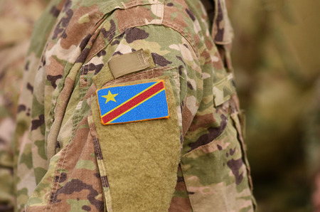 Democratic Republic of the Congo flag on soldiers arm. Democratic Republic of the Congo troops (collage) Imagens