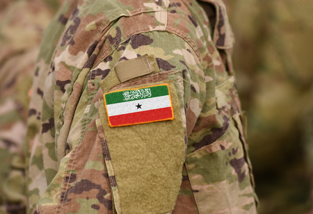 Somaliland flag on soldiers arm (collage). Imagens