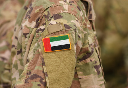Flag of United Arab Emirates (UAE) on soldiers arm (collage).