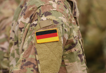 Flag of Germany on soldiers arm (collage).