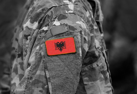 Flag of Albania on soldiers arm (collage). Imagens