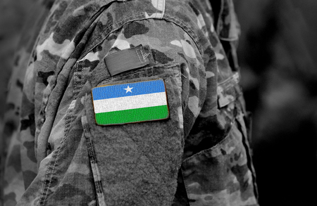 Flag of Puntland State of Somalia on soldiers arm. Puntland State of Somalia flag on military uniform. Army, troops, Africa (collage).