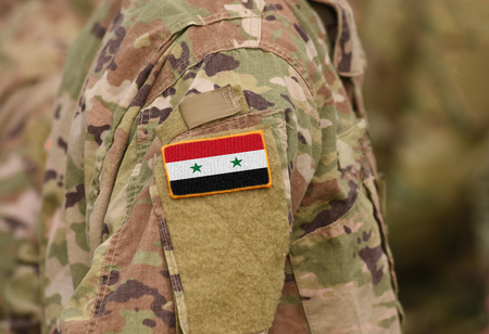 Flag of Syria on soldiers arm (collage). Banque d'images