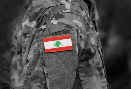 Flag of Lebanon  on military uniforms.  Lebanon  flag on soldiers arm (collage). Stok Fotoğraf - 117772558