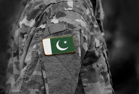 Flag of Pakistan on military uniforms. Pakistan flag on soldiers arm (collage). Stock fotó