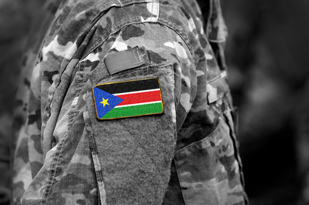 Flag of South Sudan on soldiers arm. South Sudan flag on military uniform. Army, troops, Africa (collage). Stok Fotoğraf