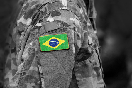 Flag of Brazil on soldiers arm. Flag of Brazil on military uniforms (collage).