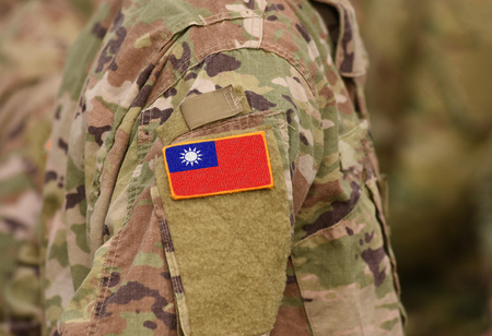 Flag of Taiwan on soldiers arm. Flag of Taiwan on military uniforms (collage). Stok Fotoğraf