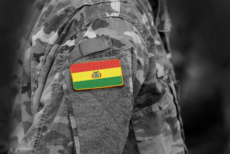 Flag of Bolivia on soldiers arm. Flag of Bolivia on military uniforms (collage). Standard-Bild