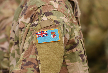 Flag of Fiji on soldiers arm. Flag of Fiji on military uniforms (collage).