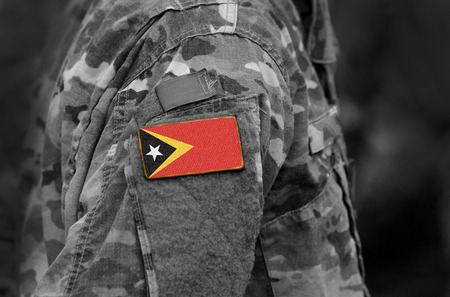 Flag of East Timor on soldiers arm. Flag of East Timor on military uniforms (collage).