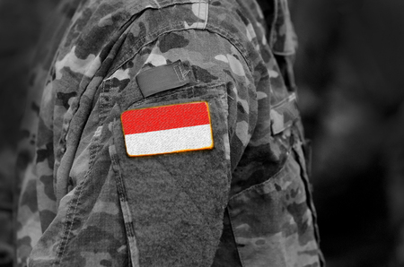 Flag of Indonesia on soldiers arm. Flag of Indonesia on military uniforms (collage). Reklamní fotografie