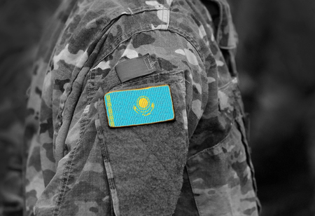 Flag of Kazakhstan on soldiers arm. Flag of Kazakhstan on military uniforms (collage).