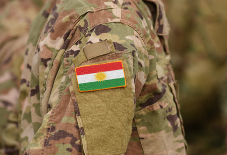 Flag of Kurdistan on soldiers arm. Flag of Kurdistan on military uniforms (collage).